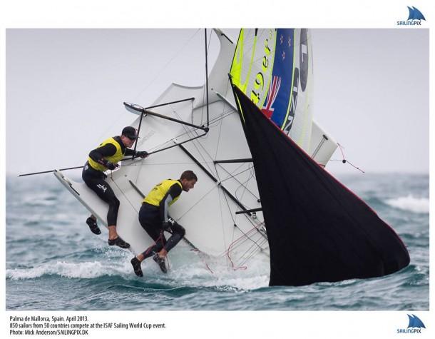 Peter Burling and Blair tuke capsize their 49er in huge waves