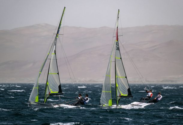 Friday August 09, 2019 - Marco Grael and Gabriel Borges from Brazil, left, Alexander Heinzemann and Justin Barnes from Canada, right, during the medal race of  During Men's Skiff of Sailing at the Bahia de Paracas at the Pan American Games Lima 2019. Copyright  Guillermo Arias / Lima 2019   Mandatory credits: Lima 2019 ** NO SALES ** NO ARCHIVES **